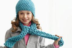 Child wearing crocheted scarf and hat