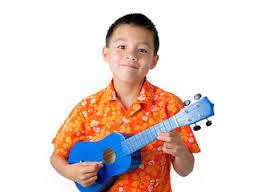Child playing the ukulele