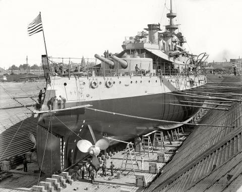 Photo of the USS Oregon in dry dock at the Boooklyn Navy Yard